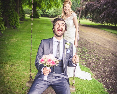 An image of a groom on a swing at Rise Hall
