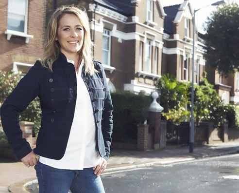 An image of Sarah Beeny by some houses